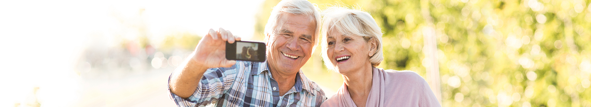 Older couple taking photo together